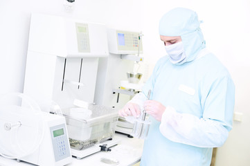 Pharmaceutical researcher with friability and abrasion tester in laboratory