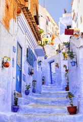Street with stairs in medina of moroccan blue town Chaouen