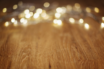 Wooden table with bokeh lights