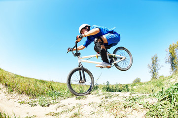 cyclist riding jumping with bicycle cross-country