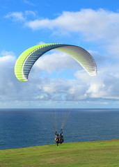Hang Glider flying over the beach at glide port