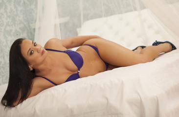 Beautiful sexy lady in elegant purple panties and bra.