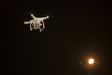 Flying drone working at night ,Thailand.