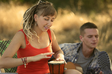 Pretty young girl inspired with a drum