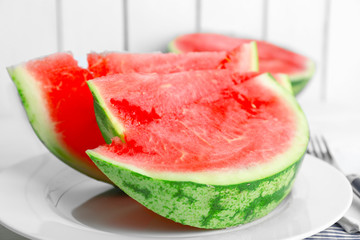 Sliced watermelon on white plate