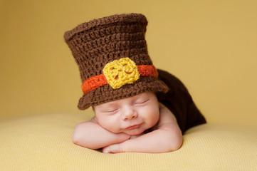 Smiling Newborn Baby Boy Wearing a Pilgrim Hat