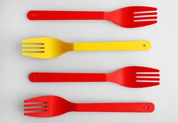 Disposable colourful forks isolated on white, top view, Individuality concept