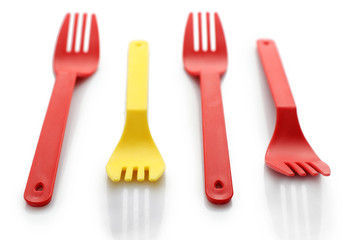 Disposable colourful forks isolated on white, Individuality concept