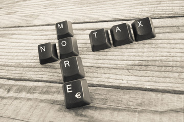 NO MORE TAX wrote with keyboard keys on wooden background