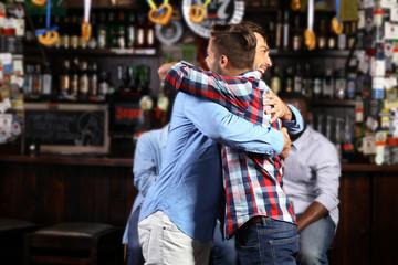 Young people having fun in a bar