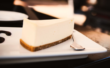 Slice of  cheesecake on white plate