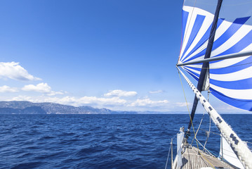 Sailing ship yachts with blue white sails in the Sea. Luxury boats. .