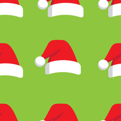 seamless pattern which repeats Christmas hat on a green background