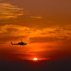 Combat helicopter in the sky