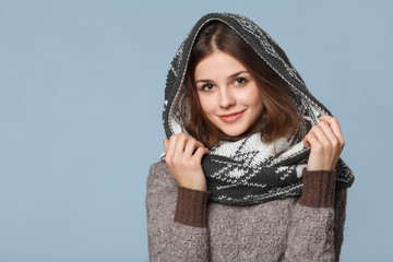 Christmas girl wearing knitted wear scarf. Young beautiful smiling girl, winter concept, isolated