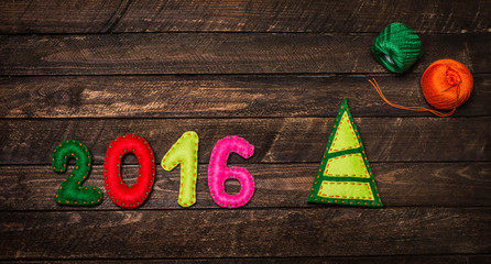 New year background with christmas tree toy made of felt