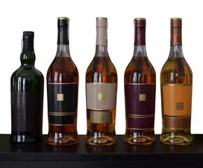 set of alcohol bottles isolated on white