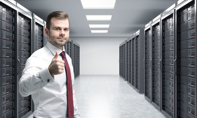 man with his right thumb up in server room for data storage, pro