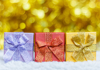 Present boxes, gift boxes for Christmas and new year on sparkling golden blurred bokeh background