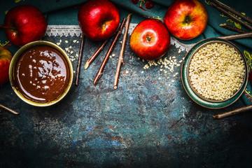 Ingredients for sweet chocolate  apples  making on rustic wooden dark baground, top view, border