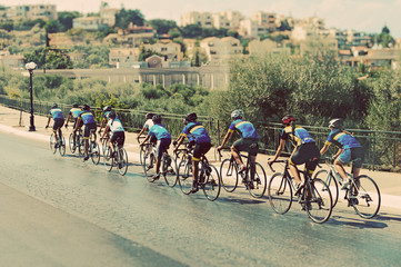 Cyclists during the race on city street.