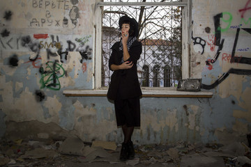 Gothic girl in old abandon kindergarden