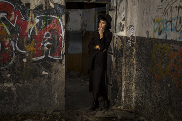 Gothic girl in old abandon kindergarden