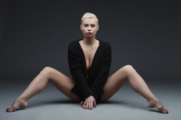 Beautiful young woman sitting with legs spread