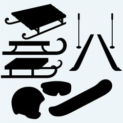 Set equipment for snowboarding, pair skis and wooden sled. Isolated on blue background. Vector silhouettes