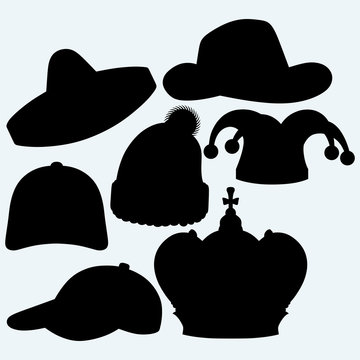 Set of headgear. Crown, winter hat, baseball cap, cowboy hat, jester hat and mexican. Isolated on blue background. Vector silhouettes
