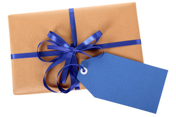 Plain brown paper package or parcel, blue gift tag or label
