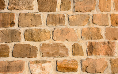 Sandstone brick wall bathed in afternoon sun