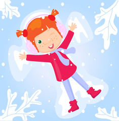 A girl making a snow angel in winter park