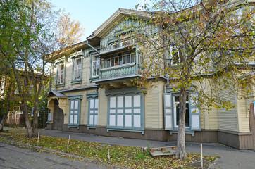 The wooden two-storey house with balcony on Irkutsk street