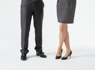 Closeup of businessman's and businesswoman's legs