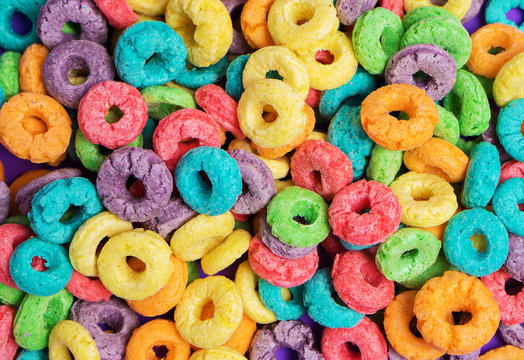 Colorful cereal  on a purple  background