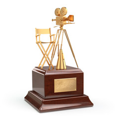 Film award. Gold vintage movie camera and chair of the director.