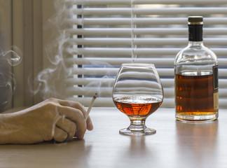 Brandy and smoke cigarettes.