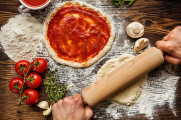 Zelfklevend Fotobehang Pizzeria Fresh original Italian raw pizza preparation