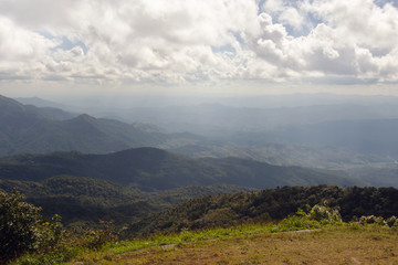 View of grass, mountain, and cloudy blue sky in Inthanon national park Chiangmai city Thailand