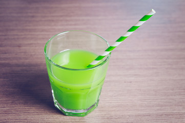 The glass of green juice