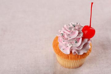 Tasty cupcake on light background