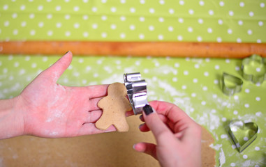Woman hand prepare gingerbread for Christmas