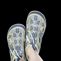 Isolated feet on casual trekking footware