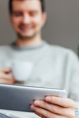 Happy man using tablet