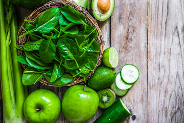 Wall Mural - Mix of green fruits and vegetables on rustic wooden background