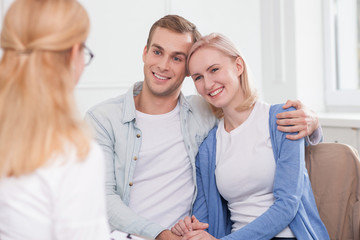 Cute married couple is consulting skillful therapist