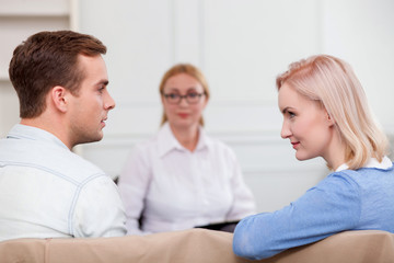 Cheerful married couple is visiting professional therapist