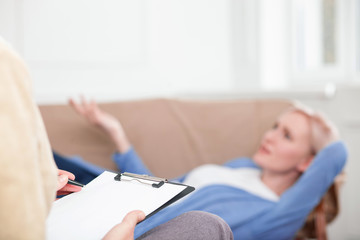 Cheerful girl is sharing her feelings with therapist