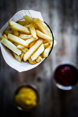 French fries on rustic wooden background
